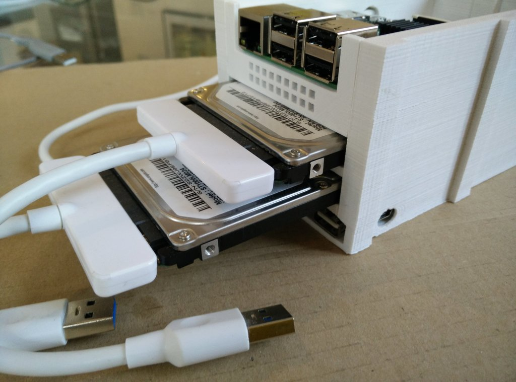 The hard drives being inserted into the case