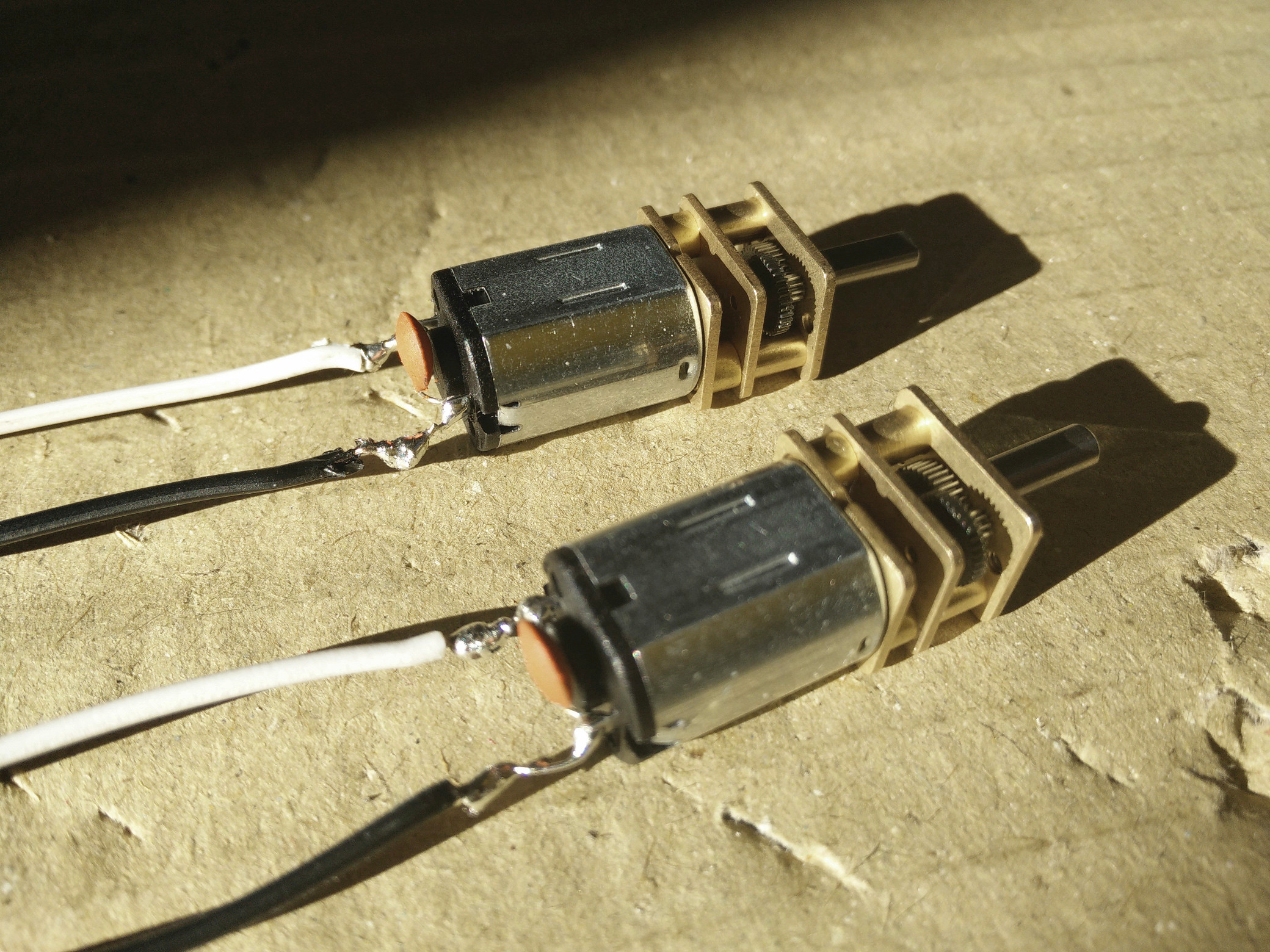 The wires are soldered to the motors with added parallel capacitors
