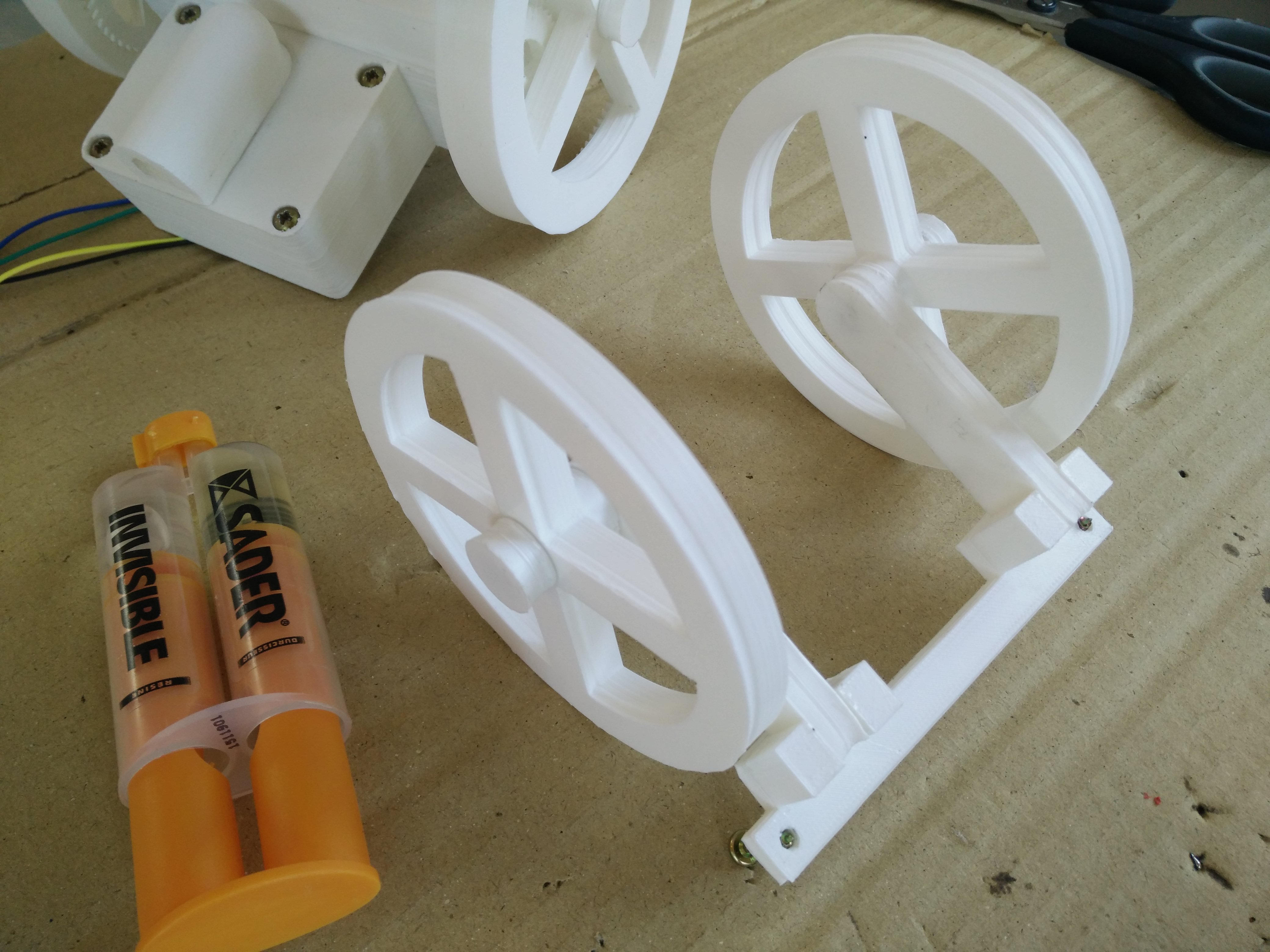 The back support glued with back wheels attached
