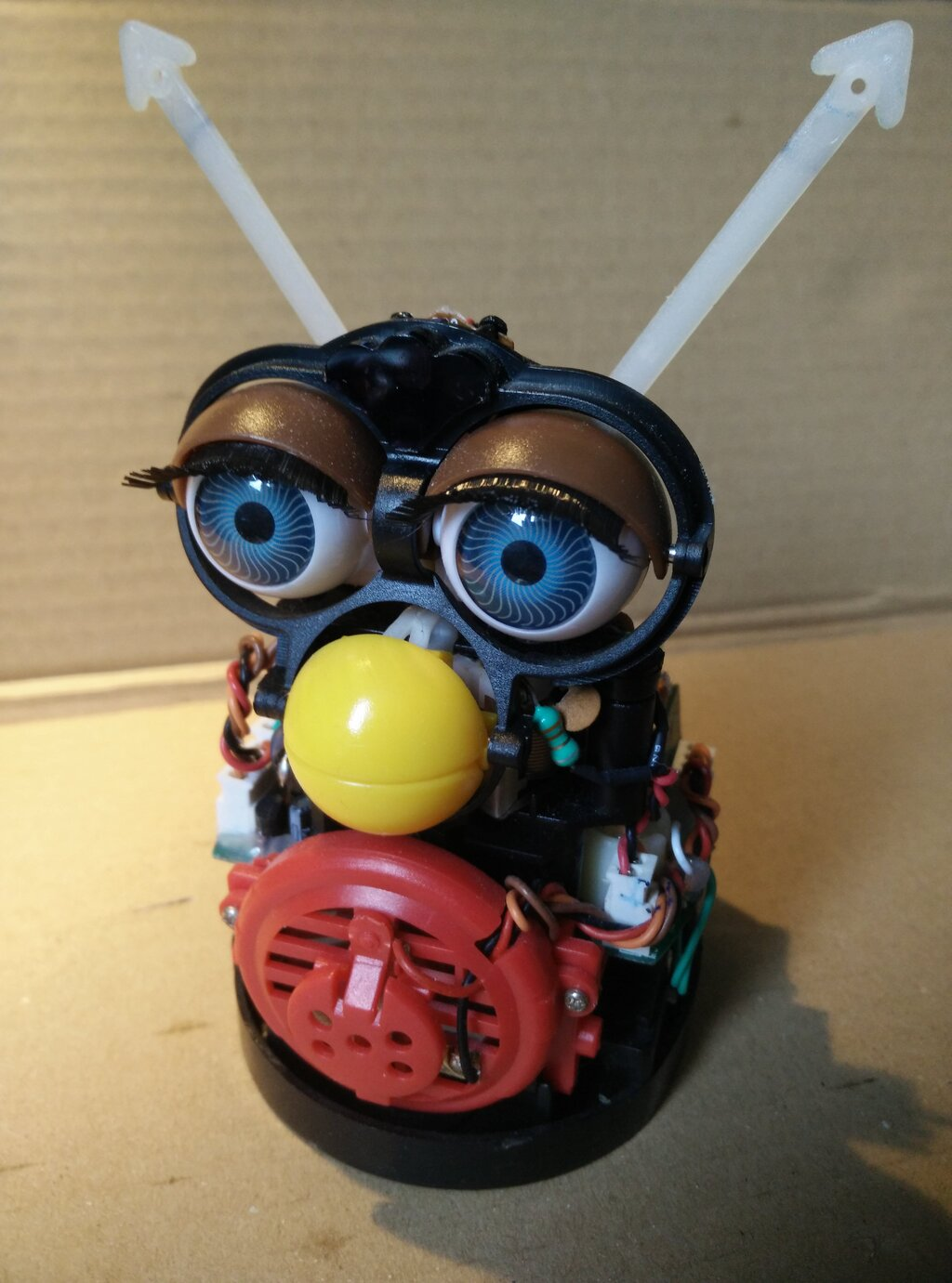 The original Furby with its fur and carapace removed